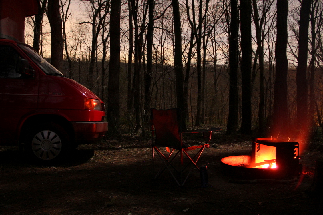 The Van Enjoying The Heat Of The Campfire